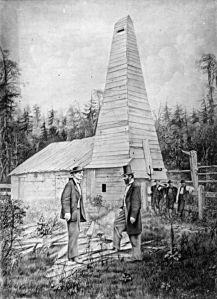 Edwin Drake (right)stands  before his oil well in1859, Titusville PA  Courtesy, Wikimedia Commons