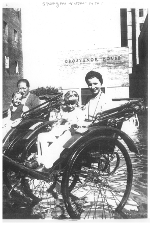 1939-Shanghai-Cookie (age 2) Amah Paula (age 6) Doris (age 32)-we ride in rickshas to avoid floodwaters at Grosvenor House, our apartment building in the International Settlement copy