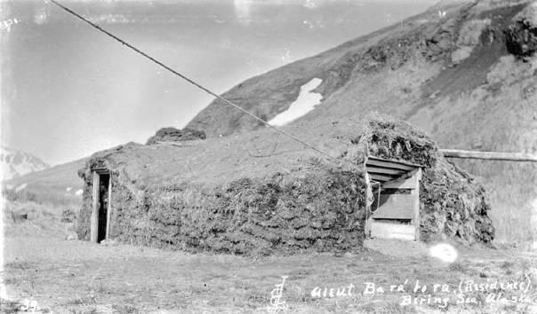 aleut_barabara,_or_sod_hut,_akutan,_bering_sea,_ca_1912_(thwaites_14)